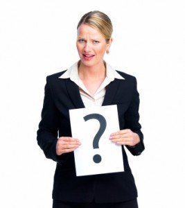 Confused business woman holding a paper with question mark